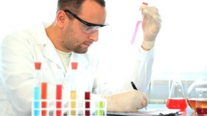 stock-footage-male-scientist-examine-test-tubes-with-chemicals-and-writing-results